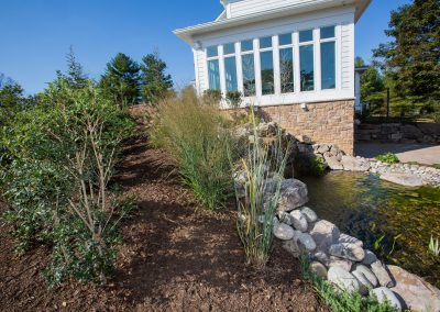 Landscaping with waterfall by Frederick Landscaping Maryland