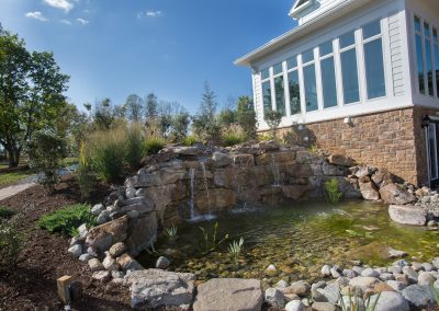 Pond with Water fall and plantings in Middletown MD. Pond is dog friendly.