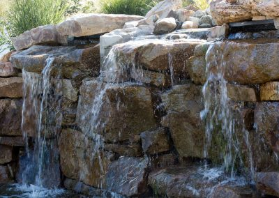 Natural boulder waterfall and water feature by Frederick Landscaping Maryland
